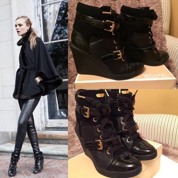 37c26569f22 Michael Kors Skid Wedge Sneakers in Black. M 54bdf295eeb16f11d523bd4f