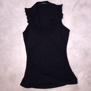 Sleeveless ruffled neckline top