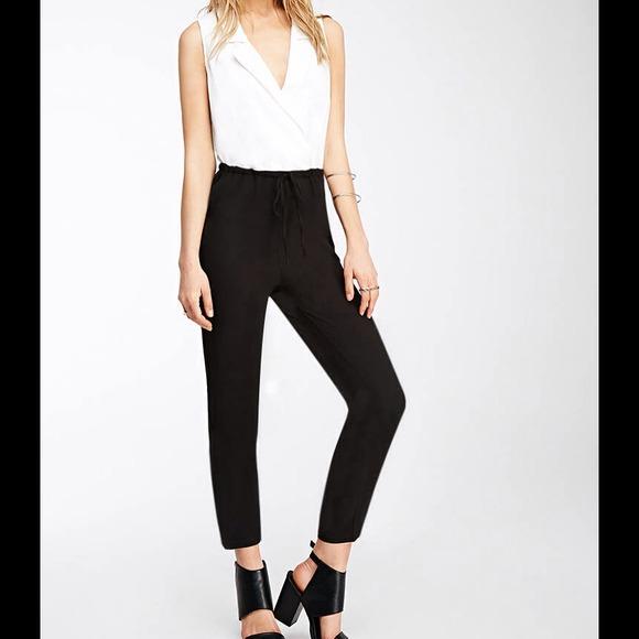 b48b32fe5b16 White black tuxedo jumpsuit colorblock surplice