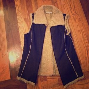 Sherpa lined faux leather vest