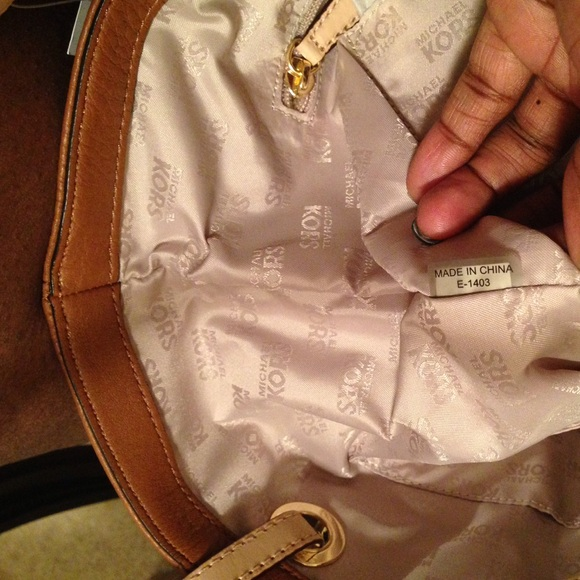eede029a6bf04 michael kors bag serial number checker miromar outlet