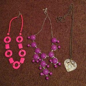 Three statement necklaces!