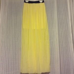 Sheer yellow pleated maxi skirt