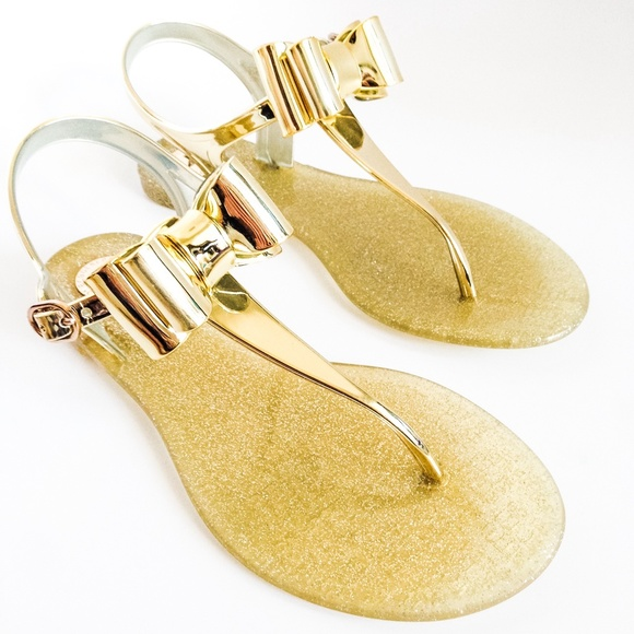 849c3168ae3b9c BCBGeneration gold bow jelly thong sandal