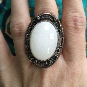 Large oval statement ring with white gem