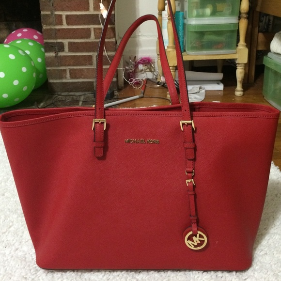 65d598804724 Red Michael kors jet set travel leather tote. M_54d19194d0a44606b1006925