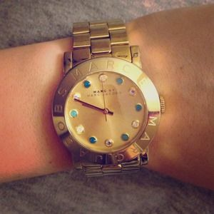 Marc Jacobs yellow gold watch.