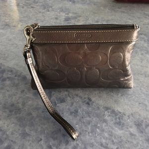 Metallic gray coach wristlet