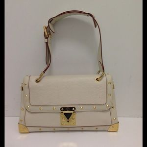 LN LOUIS VUITTON SUHALI LEATHER STUDDED TALENTUEX