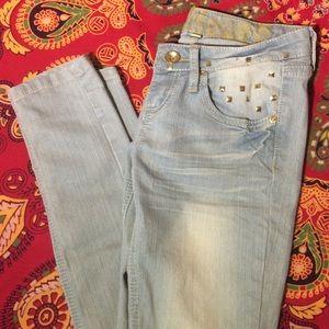 light wash studded jeans