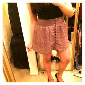 Mauve skater skirt with buttons and pockets