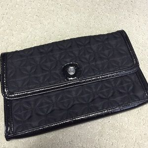 Black quilted and patent leather clutch