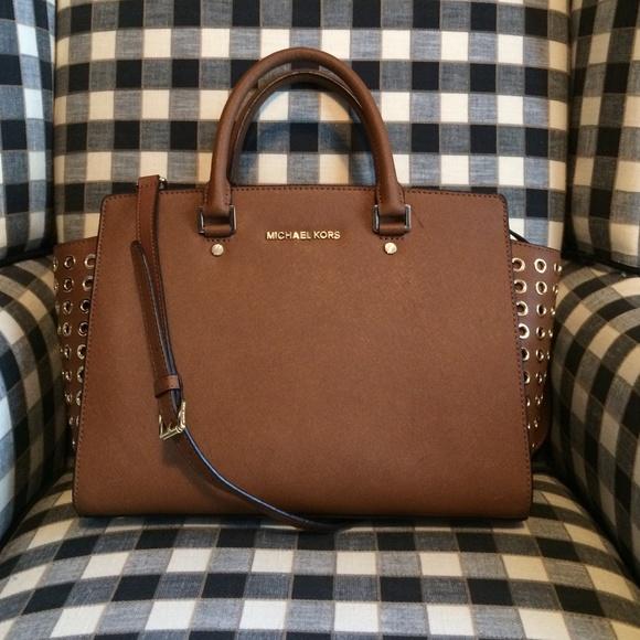 b3da6dc6b0d819 Michael Kors Selma Bag with Grommets in Luggage. M_54d6586f56b2d60c82011111