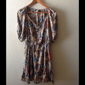 Beautiful, snakeskin print dress w/ruffled hem