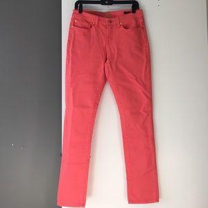 NWT Mid rise skinny coral jeans.
