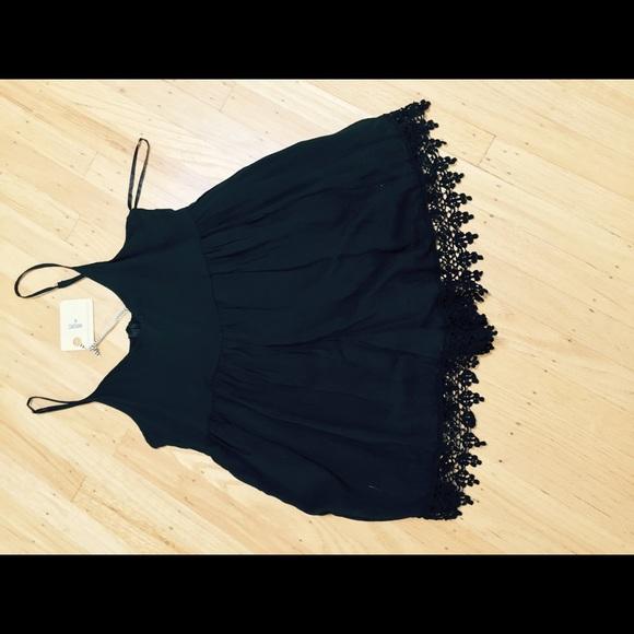 f540051e881 LF black romper with lace trim