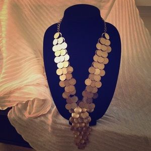 Antiqued gold tone statement piece