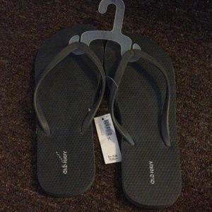 Grey flip flops