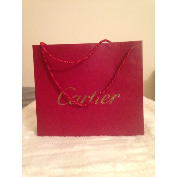 100% off Cartier Handbags - Cartier Shopping Bag from Saige's ...