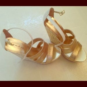 New Bebe gold and white platforms