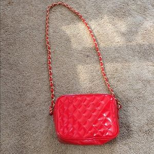 Red patent leather quilted cross body bag