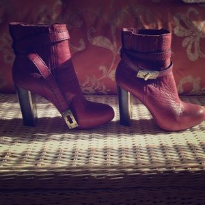BCBG MaxAzria leather booties/ gold metal details.