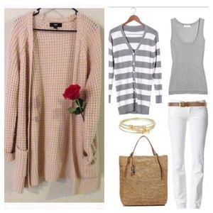 Long light pink sweater goes great with any outfit