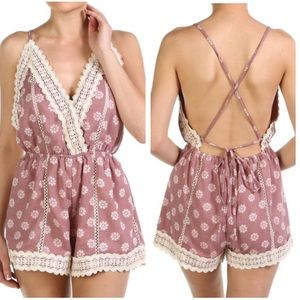 Medium-Large. Backless floral romper, light pink
