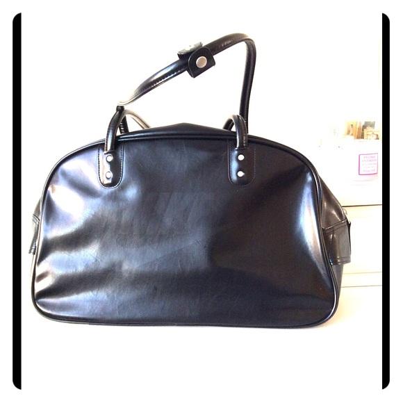 69% off Nike Handbags - Nike Logo Black Gym/Weekend Bag from ...
