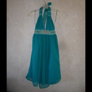 Turquoise hackles slow runged halter dress, used for sale