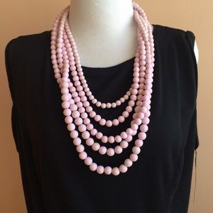 Multi strand pink bead necklace