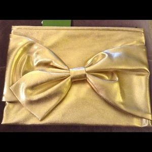 "Kate spade NWT gold bow clutch/pouch ""On Purpose"""