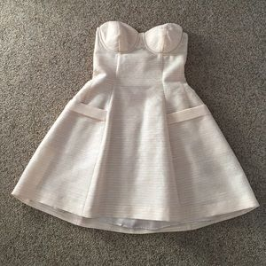 Bebe Strapless dress with pockets