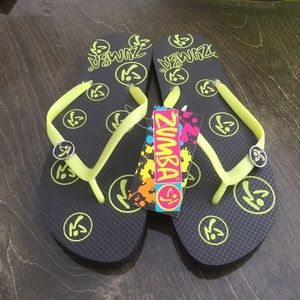New retired Zumba black and green flip flops