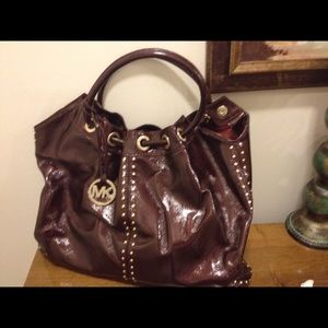 Michael Kors Patent Leather purse.