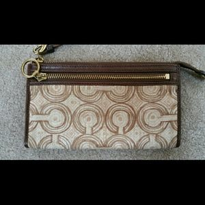 Coach brown pattern zippy wallet