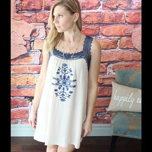 Navy and cream embroidered lace trim dress