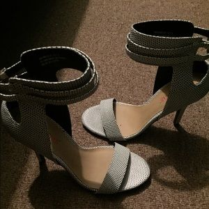Black and white strap sandal heels