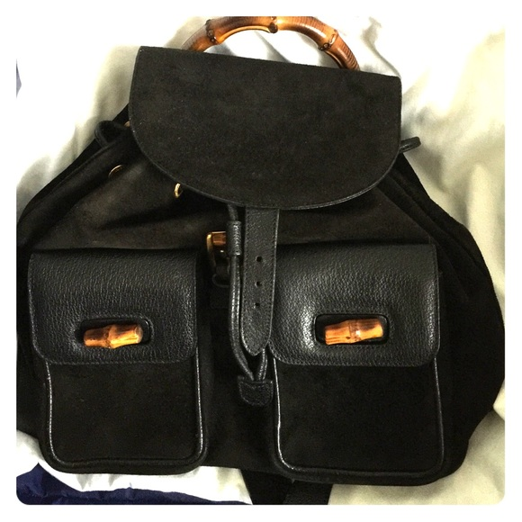 Gucci Handbags - Vintage gucci backpack black and bamboo hand 413374727a459