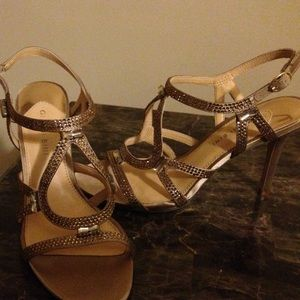 Gianni Bini size 9 gold and rhinestone shoe.