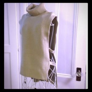 Light beige sleeveless turtleneck