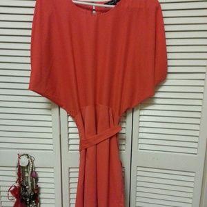 Silky orange drape dress