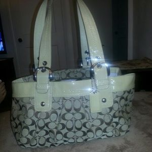 Beige coach signature handbag