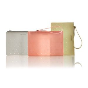Eddie Borgo Handbags - NEW Pink silicone triangle cut out wristlet clutch