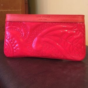 Kate Spade red patent paisley zipper pouch.