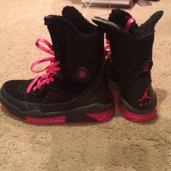 Hot pink and black Jordan boots