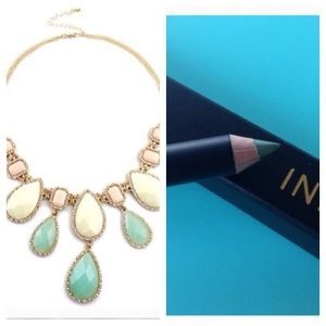Pastel necklace and organic green eyeliner