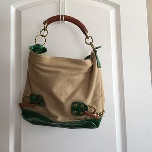Canvas and green patent leather purse.