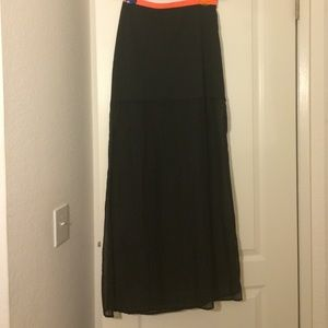 Long black skirt with a pink-orange band