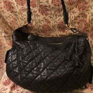 Classy quilted black leather handbag